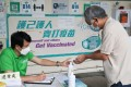 A resident queues up to get vaccinated at Choi Hung Road Badminton Centre. Hong Kong is still struggling to ramp up its Covid-19 inoculation rate. Photo: Edmond So