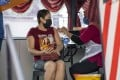 A woman gets vaccinated against Covid-19 in Selangor, Malaysia. Photo: Xinhua