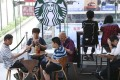 Starbucks in Hong Kong has raised the price on most of its drinks by 5 per cent. Photo: Dickson Lee