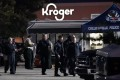 Law enforcement personnel work in front of a Kroger grocery store after a shooting in Collierville, Tennessee on Thursday. Photo: AP