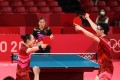 Japan's Mima Ito and Jun Mizutani of celebrate winning their Tokyo 2020 Olympic Games table tennis mixed doubles gold match against Xu Xin China Liu Shiwen of China. Photo: Reuters