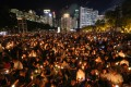 Hongkongers hold up candles at Victoria Park in Causeway Bay, at the June 4 vigil in 2018. Photo: Dickson Lee