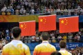 Chinese medallists (from left) Wang Liqin, Ma Lin and Wang Hao stand at attention for the national anthem during the awards ceremony for men's singles table tennis, at the Beijing Olympic Games on August 23, 2008. Ma won gold, defeating Wang Hao who took silver, while Wang Liqin took bronze. Photo: AFP