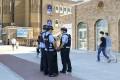 Police officers near the International Grand Bazaar in Urumqi in China's Xinjiang Uygur autonomous region in July. Photo: Kyodo
