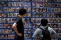 People look at console games at a store in Beijing on August 31, 2021, a day after China announced a drastic cut to children's online gaming time to just three hours a week. Photo: AFP