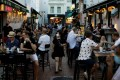 People dine at Boat Quay in Singapore. Photo: Reuters