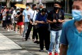People queue up to take disease antigen rapid tests in Singapore. Photo: Reuters