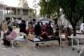 People gather outside a hospital following an earthquake in Harnai, Balochistan. Photo: QuettaVoice.com via Reuters