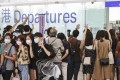 People wave goodbye to their families or friends at Hong Kong International Airport. Almost 65,000 Hong Kong nationals have applied for the British National (Overseas) visa scheme. Photo: K. Y. Cheng