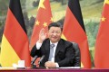 Chinese and German national flags form the backdrop as President Xi Jinping meets Chancellor Angela Merkel via video link from Beijing on Wednesday. Photo: Xinhua