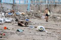 A man walks past piles of rubbish on Silverstrand Beach in Sai Kung on Thursday. Photo: May Tse
