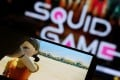 The Netflix series Squid Game is seen being played on a mobile phone on September 30. The show's graphic violence makes it unlikely to get an official release in China, where the show is already widely pirated, making it even less appealing to video-streaming platforms and broadcasters. Photo: Reuters