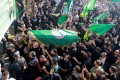 Supporters of the Shiite Amal Movement carry the coffin of a man who was killed in Thursday's violence in Beirut. Photo: Reuters