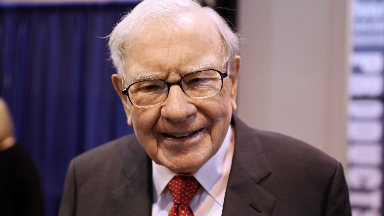 Warren Buffett has traded his old flip phone for Apple's iPhone
