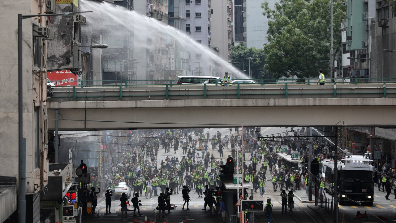Hong Kong protests: At least 180 people arrested as police deploy water cannon and tear gas