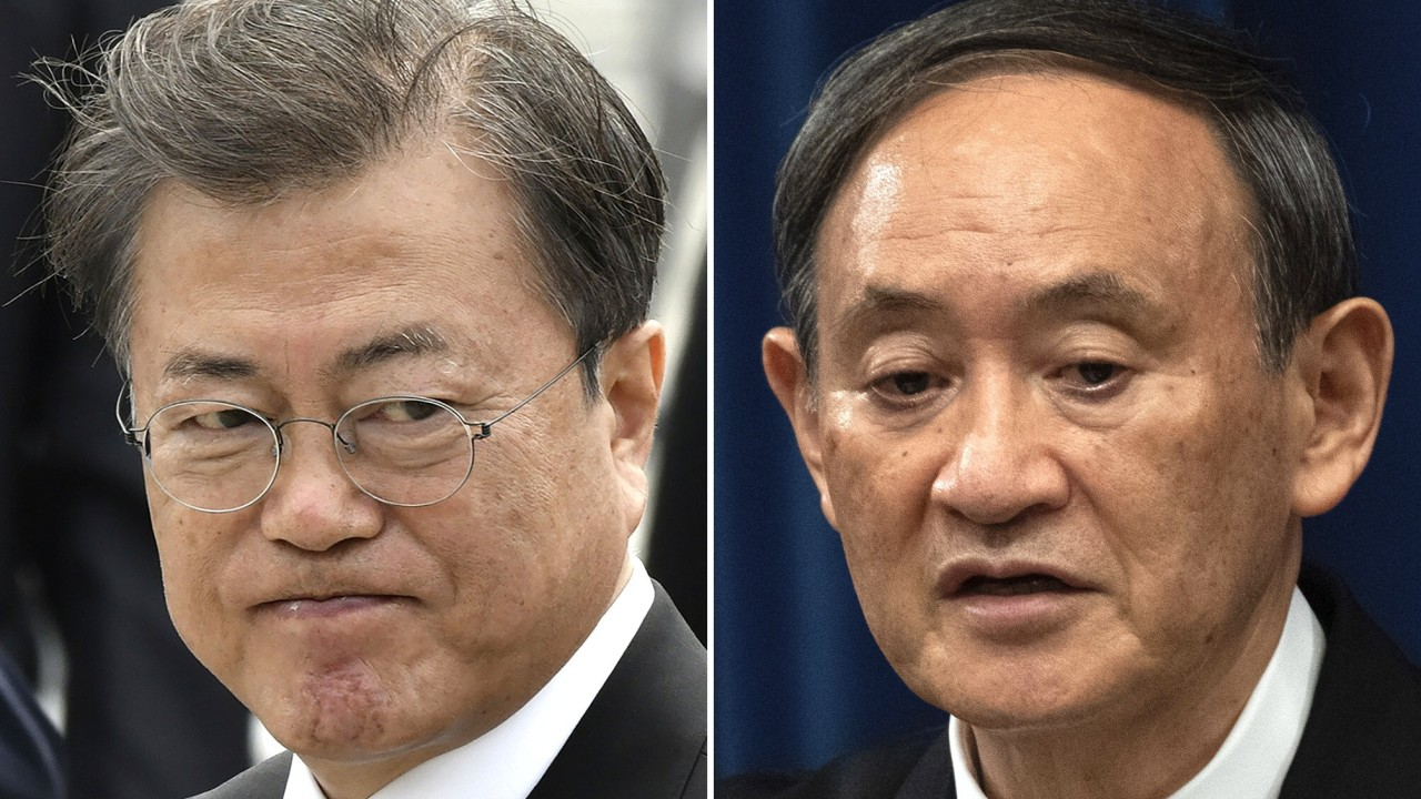 Japan's Yoshihide Suga urges better ties during first talks with South Korea's Moon Jae-in