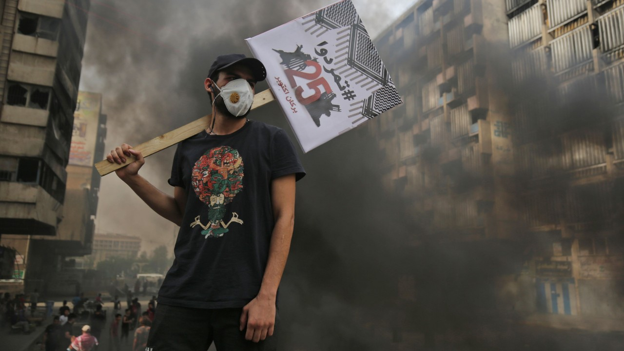 Tear gas fired as thousands mark one year of Iraq protests