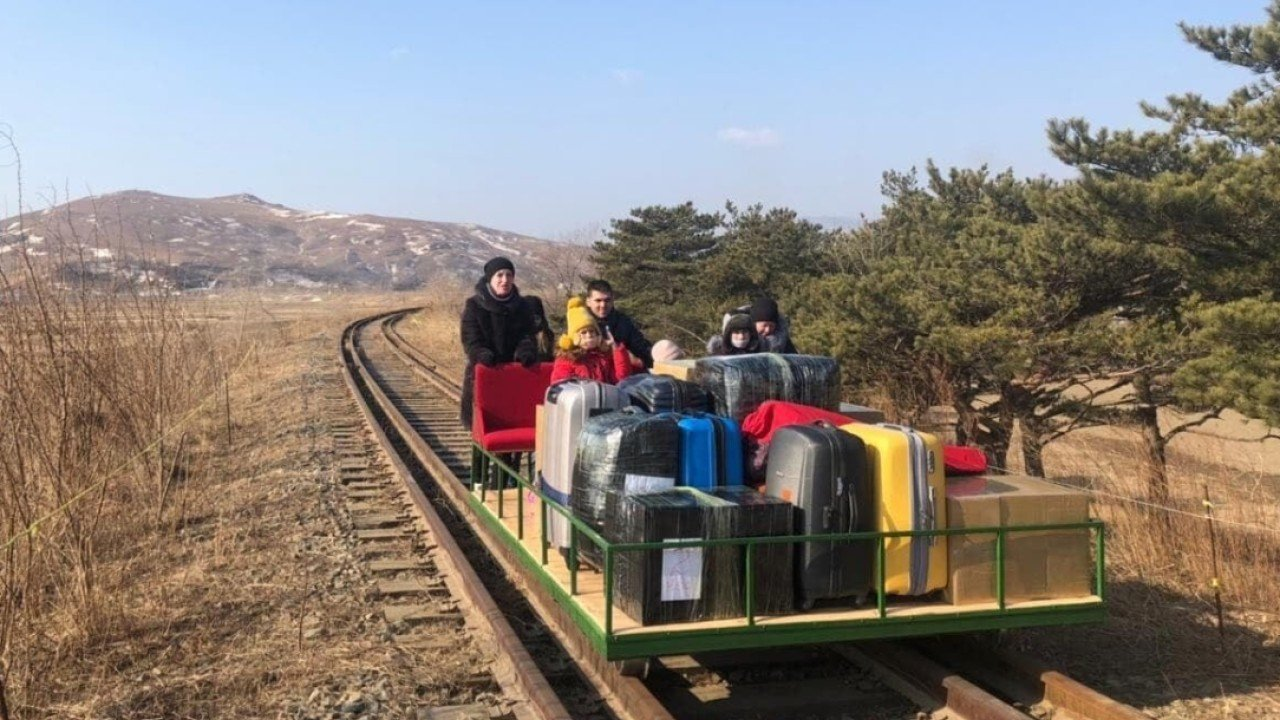 Russian diplomats leave North Korea by pushing themselves over border on rail trolley