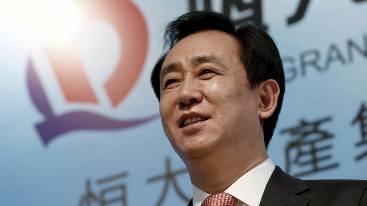 Evergrande denies rumours of bankruptcy and reorganisation after weekend of protests at offices across China