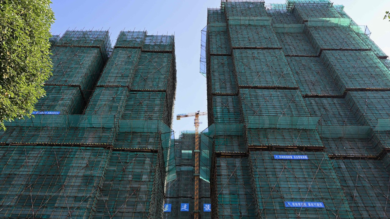 China's home-price growth weakens to eight-month low on cooling measures while Evergrande's struggles keep buyers away