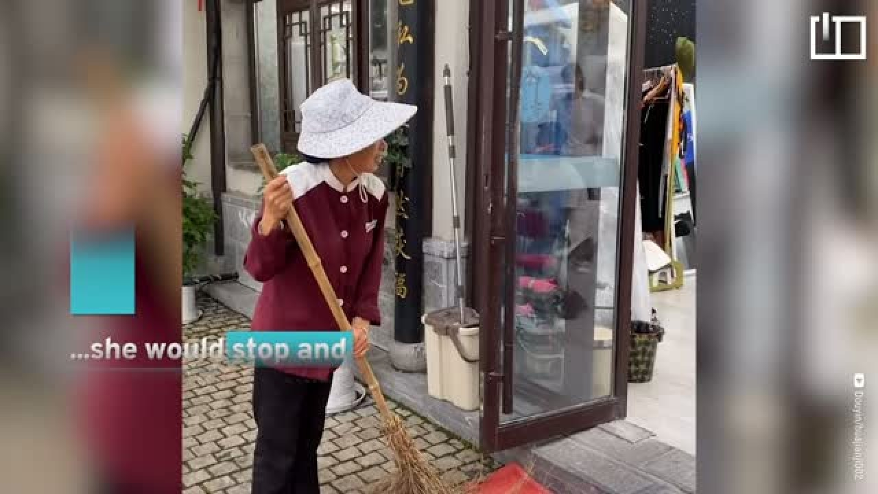 Street cleaner in China gets surprise first photo shoot