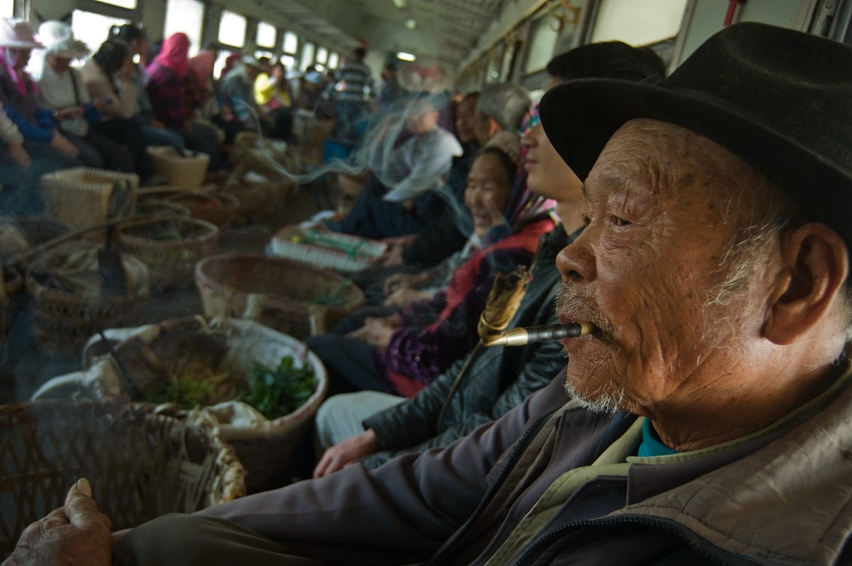 A train from Guizhou to Yunnan Province in February 2014. The seats were removed to facilitate the transport of vegetables.