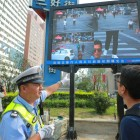 Shenzhen's jaywalkers get scolded on WeChat and shamed on public screens