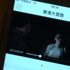 People can watch newly-released movies in cinemas on their smartphones in China