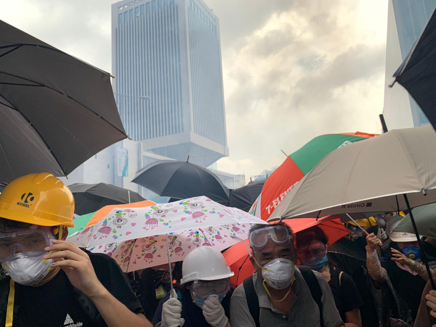 Police fire tear gas at Hong Kong protesters sending crowds running for cover. Photo: Kinling Lo