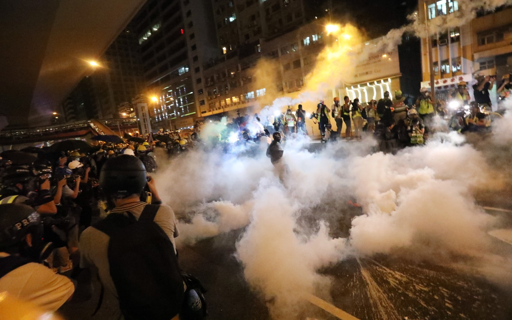 As it happened: Hong Kong police fire rounds of tear gas in