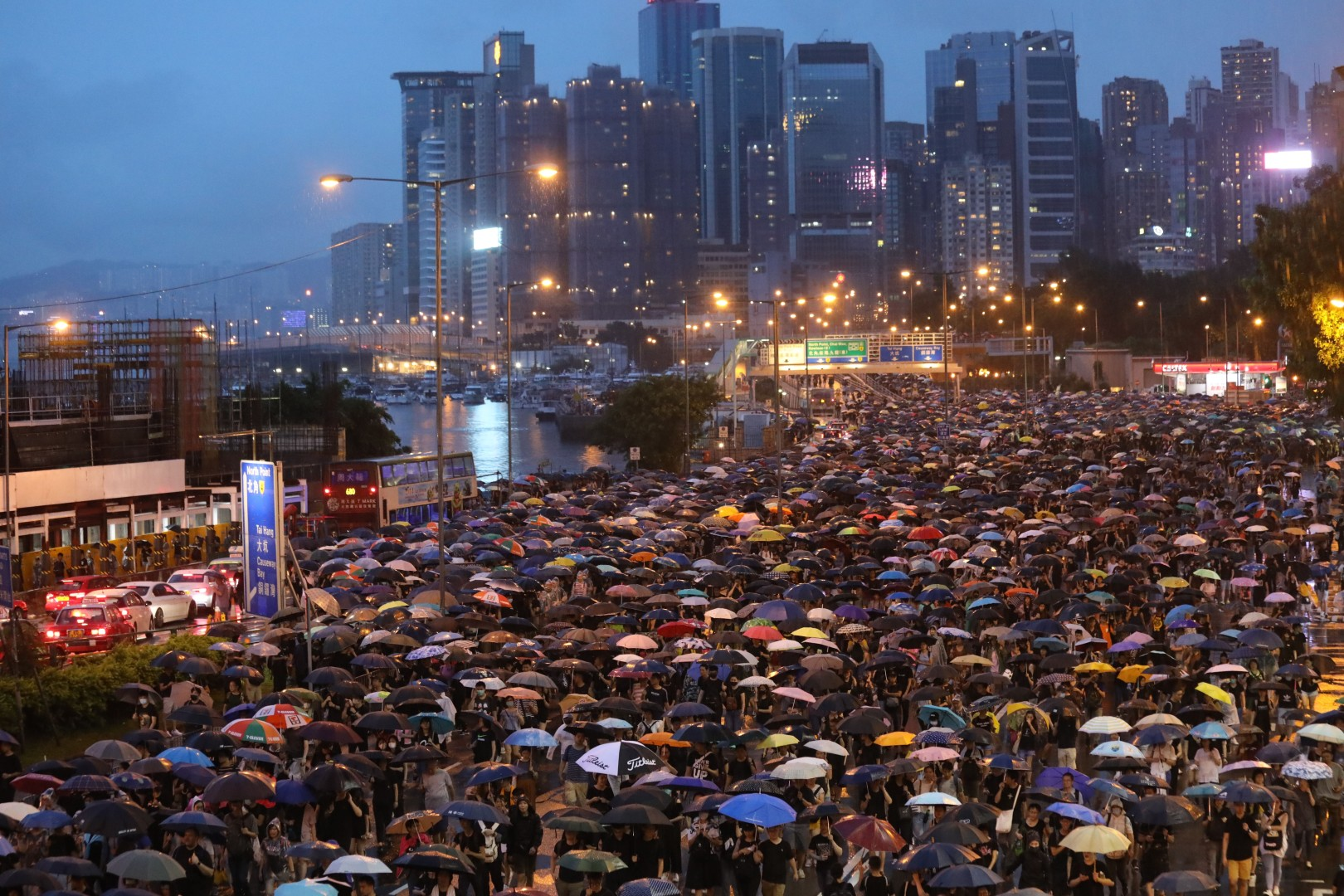 Hong Kong protesters defy police ban, but demonstrations remain peaceful