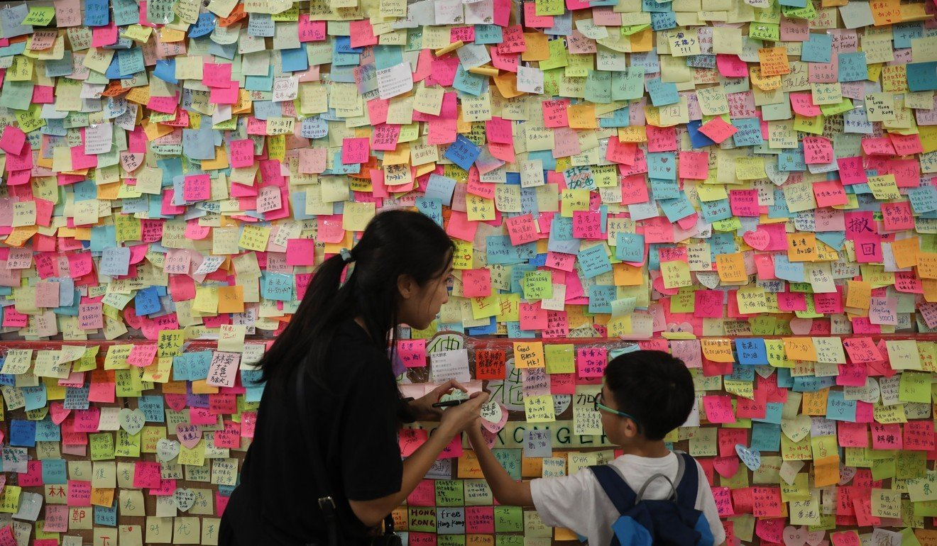 Lennon Walls' spring up across Hong Kong as more than 200 police in