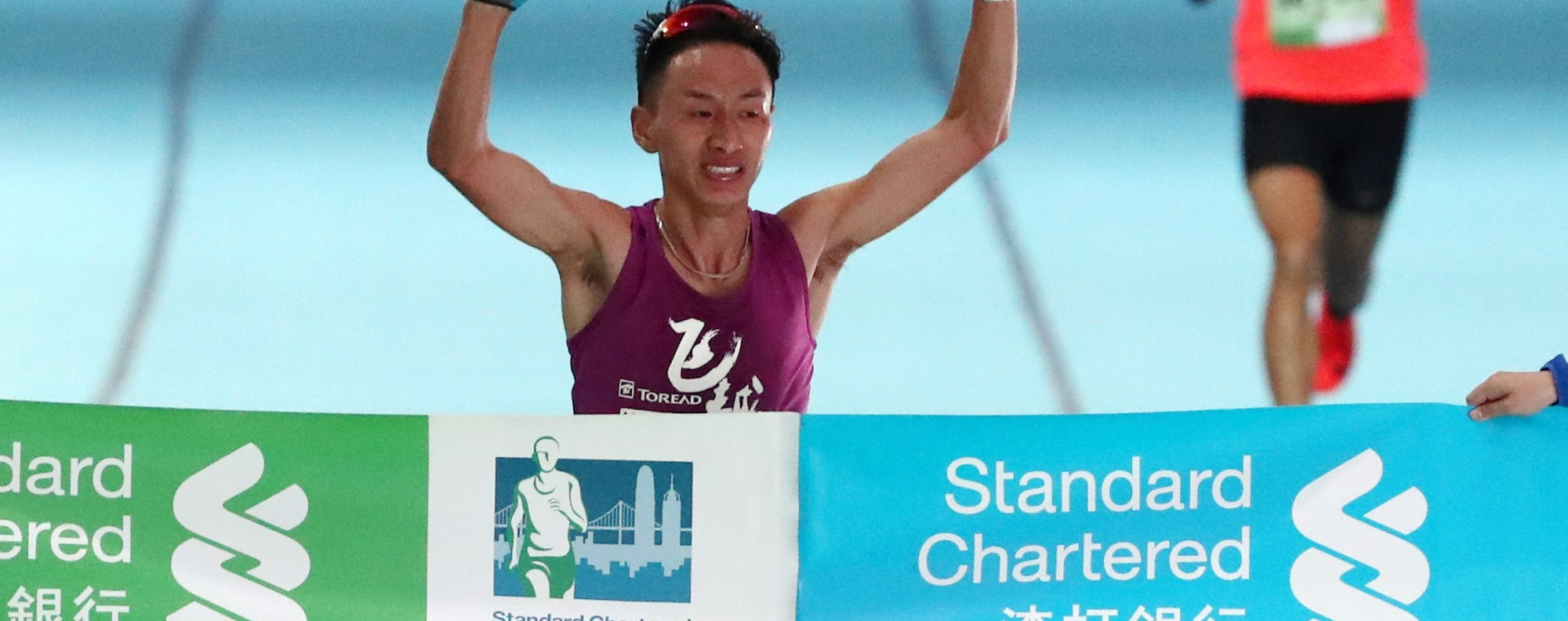 Jia Erenjia of China wins the men's half marathon at the Hong Kong Marathon. Photo: Nora Tam