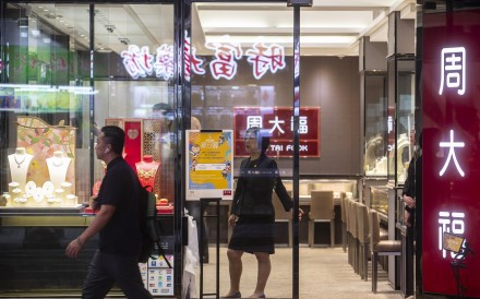 It can be a bit lonely these days as a retail clerk. Here, an employee stands at the door of a Chow Tai Fook Jewellery Group store in the Causeway Bay district of Hong Kong on August 29, 2019. Photo: Bloomberg