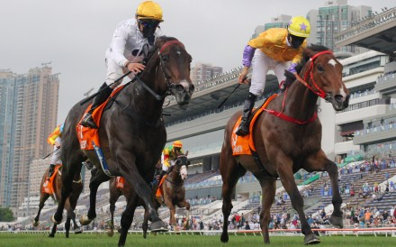 Vincent Ho guides Golden Sixty (left) to victory in the Group One Champions Mile at Sha Tin on Sunday. Photos: Kenneth Chan