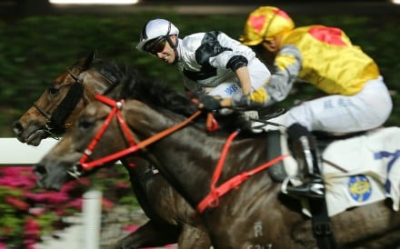 Neil Callan lifts Jolly Convergence to victory at Happy Valley on Wednesday night. Photos: Kenneth Chan