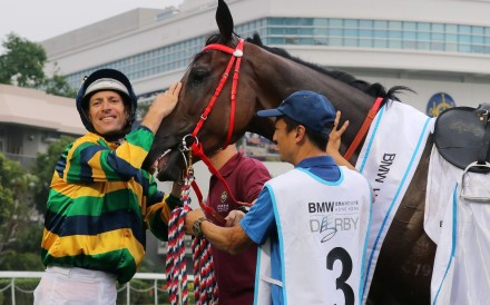 Hugh Bowman shows his love for Furore after their win in the Hong Kong Derby. Photos: Kenneth Chan