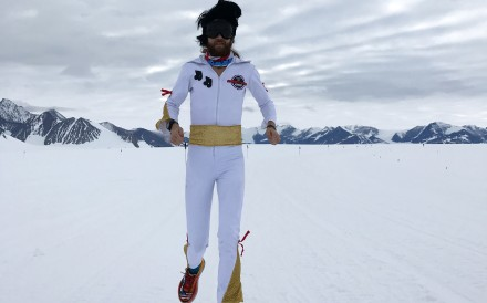 Michael Wardian runs in Antarctica dress as Elvis, one of many ways he injects fun into racing. Photo: Jennifer Wardian