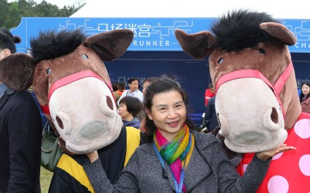 "Chinese racing fans play in the ""fun zone"" at Conghua Racecourse on Saturday. Photos: Kenneth Chan"