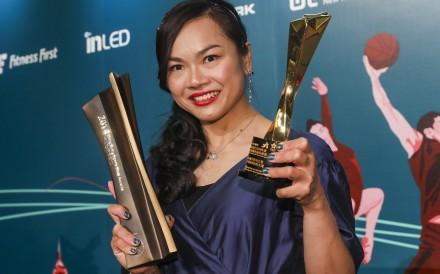 Hong Kong cyclist Sarah Lee shows off her trophies at the Hong Kong Sports Stars Awards in Wan Chai. Photo: K.Y. Cheng