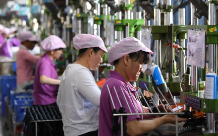 Women work on a data cable production line at a factory in Xinyu, Jiangxi province, China April 8, 2019. Photo: Reuters