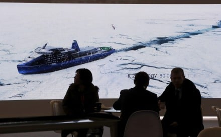Delegates watch footage of an icebreaker at the International Arctic Forum in Russia earlier this month. Photo: EPA-EFE