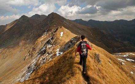 Hiking the Carpathian Mountains, in Transylvania, Romania. Photo: Alamy