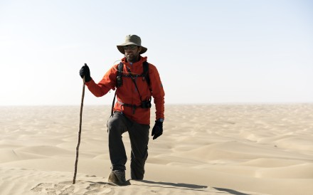 Ryan Pyle treks through the Taklamakan Desert in China while filming his television series Extreme Treks on BBC Earth.