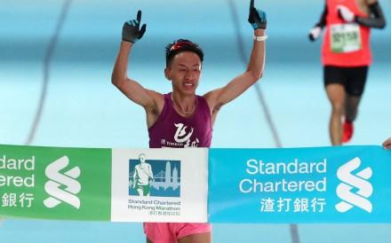 Jia Erenjia of China wins the men's half marathon at the Hong Kong Marathon. Photo: Nora Tam