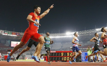 Su Bingtian (far left) wins the men's 100-metres final in a meet record of 9.92 seconds at the Asian Games in Jakarta. Photo: Kyodo