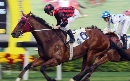 Good Standing wins under Zac Purton in February over 1,600m in Class Two. Photos: Kenneth Chan