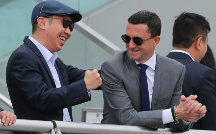 Douglas Whyte talks to an owner at Sha Tin on Sunday. Photos: Kenneth Chan