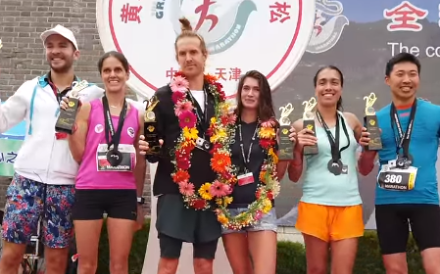 Douglas Wilson and Kali Cavey (centre pair) celebrate winning the Great Wall Marathon. Photo: Adventure Albatross Marathons