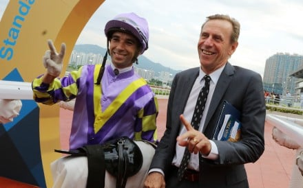 Trainer John Size celebrates his milestone with stable jockey Joao Moreira. Photos: Kenneth Chan